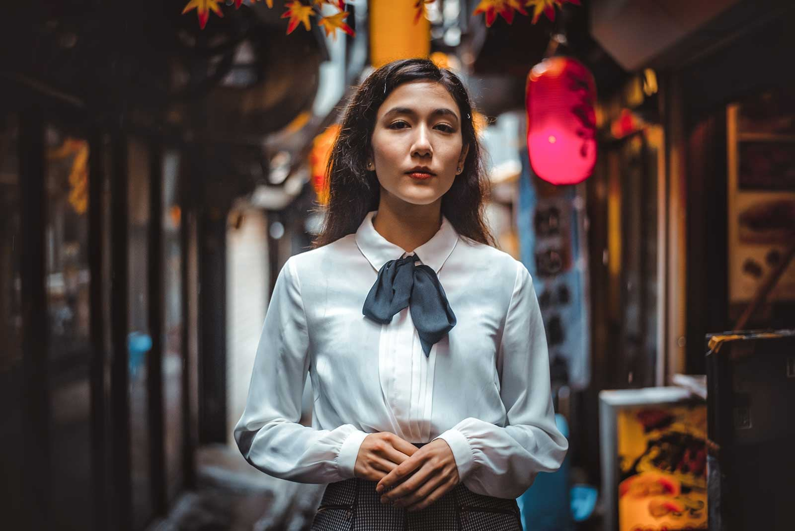 Portrait of a woman in Japanese town after editing using Lightroom portrait preset