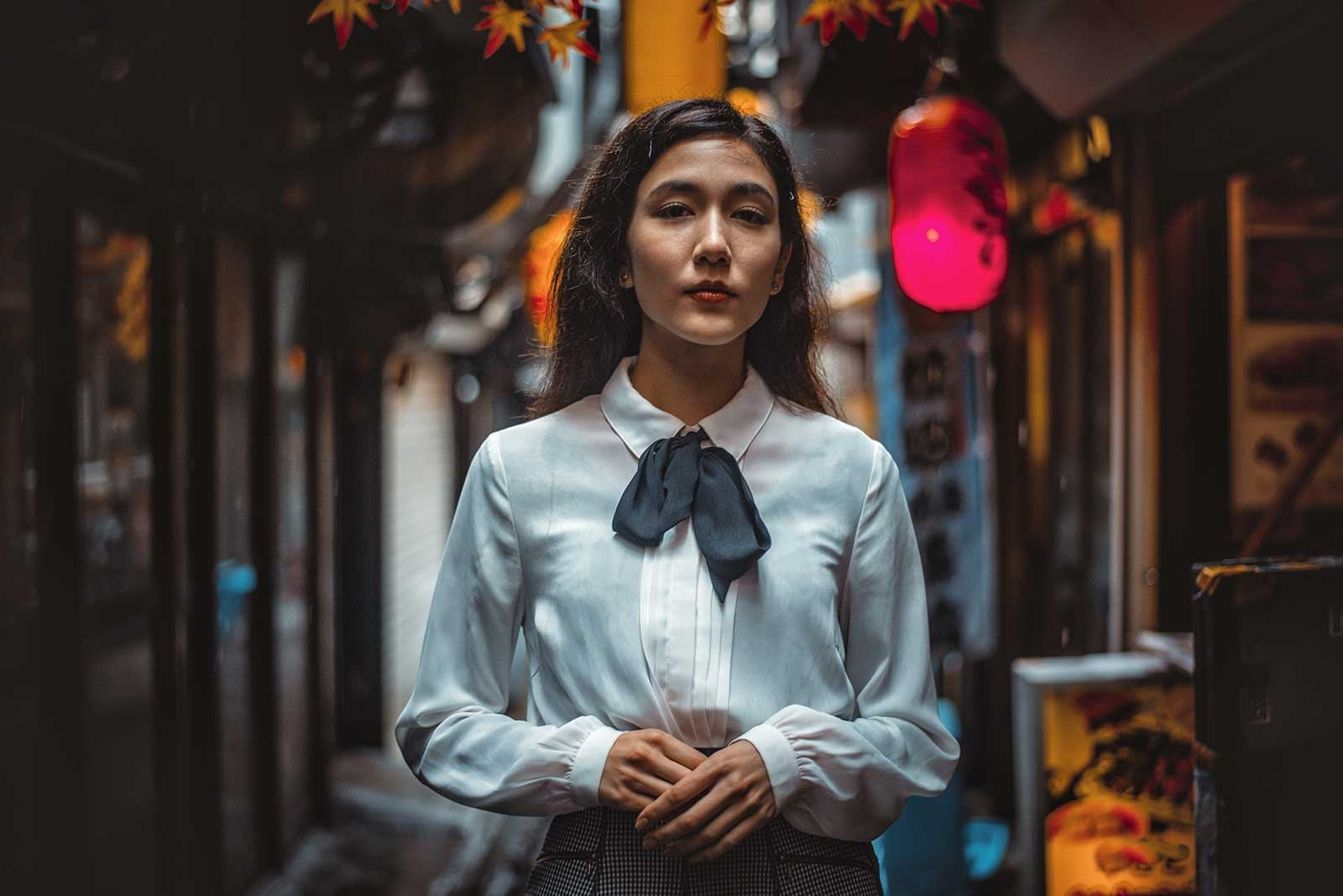 Portrait of a woman in a Japanese town before edit