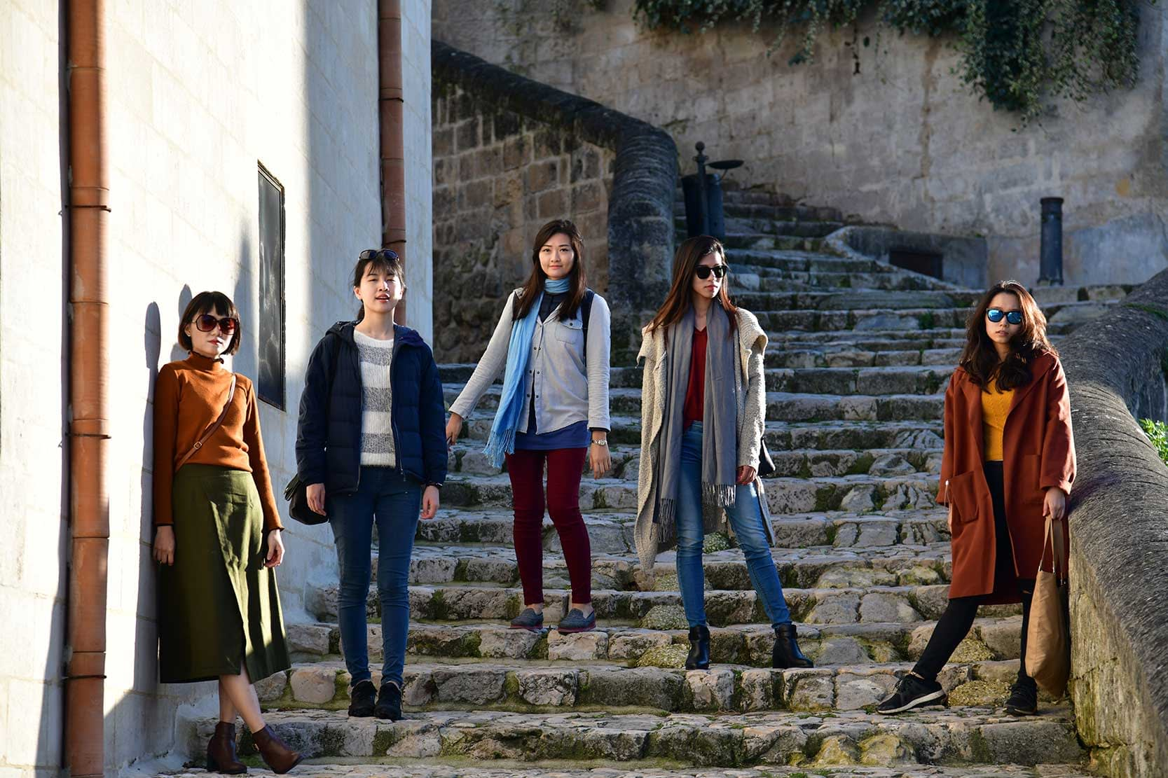 Asian friends posing as fashion models in Italy