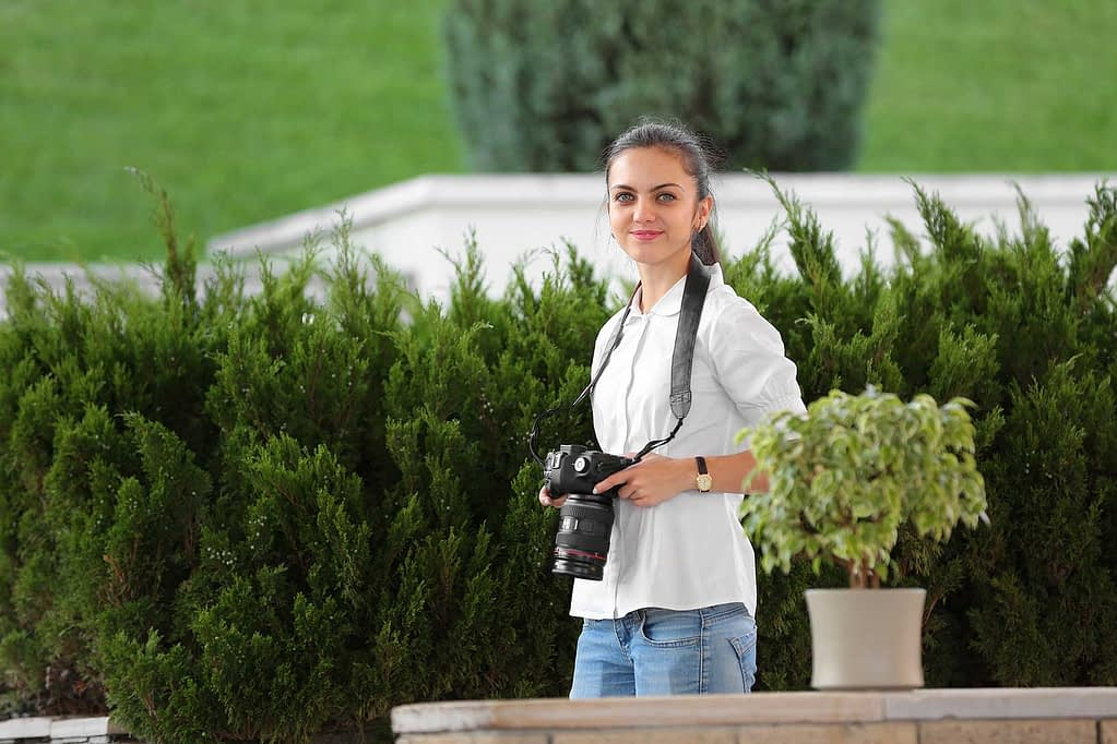 A female photographer covering a wedding event